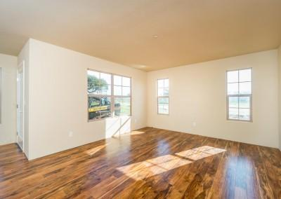 Living area of the Monterey plan with upgraded flooring