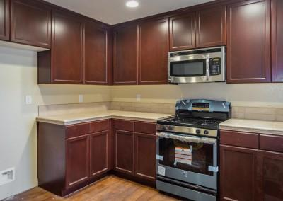 Kitchen of the Drake plan with upgraded flooring and upgraded stainless steel appliances